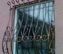 Кованные решетки на окна #80