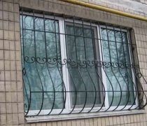 Кованные решетки на окна #60